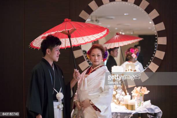 Japanese style bride and groom standing in front of mirror