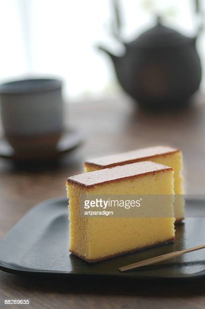 Japanese style sponge cakes on lacquer with teaset