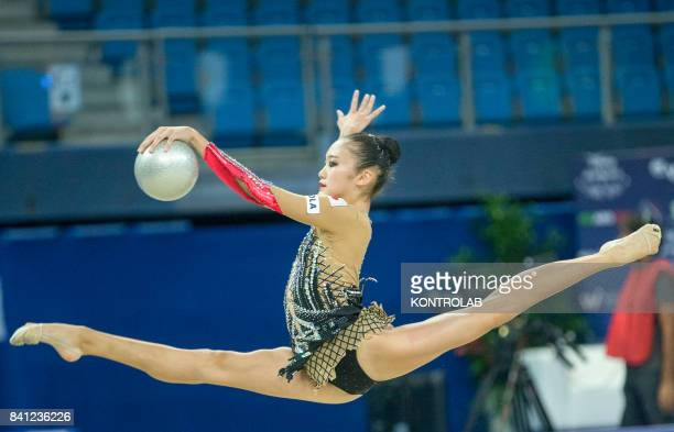 Japanese Sumire Kita performs the ball exercise during the FIG 35th Rhytmic Gymnastic World Championship in Pesaro