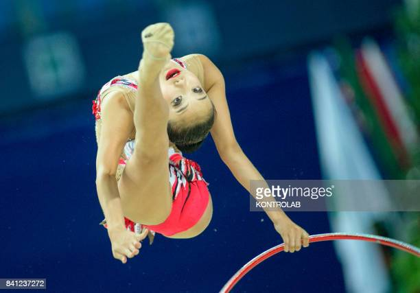 Japanese Sumire Kita performs the hoop exercise during the FIG 35th Rhytmic Gymnastic World Championship in Pesaro