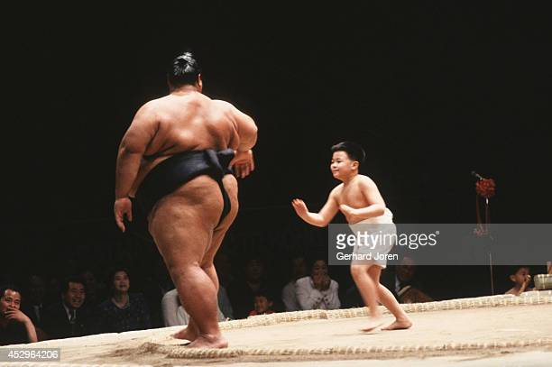 Japanese Sumo wrestler and a young boy during an exhibition tournament in Kowloon Hong Kong