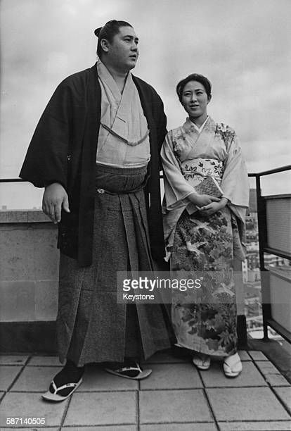 Japanese sumo wrestling champion Taiho Koki with his new wife Yoshiko during their honeymoon in London 11th June 1967 He is the youngest wrestler to...