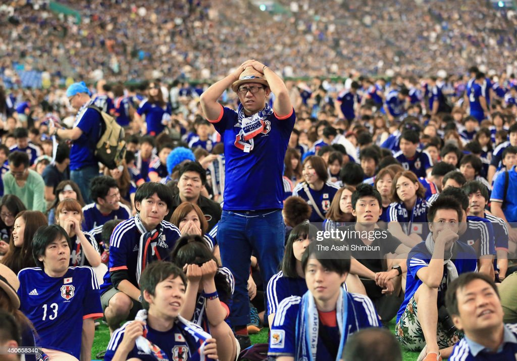 A Japanese supporter shows his dejection as Japan lost to Cote D'Ivoire during the public viewing at the Tokyo Dome on June 15, 2014 in Tokyo, Japan.