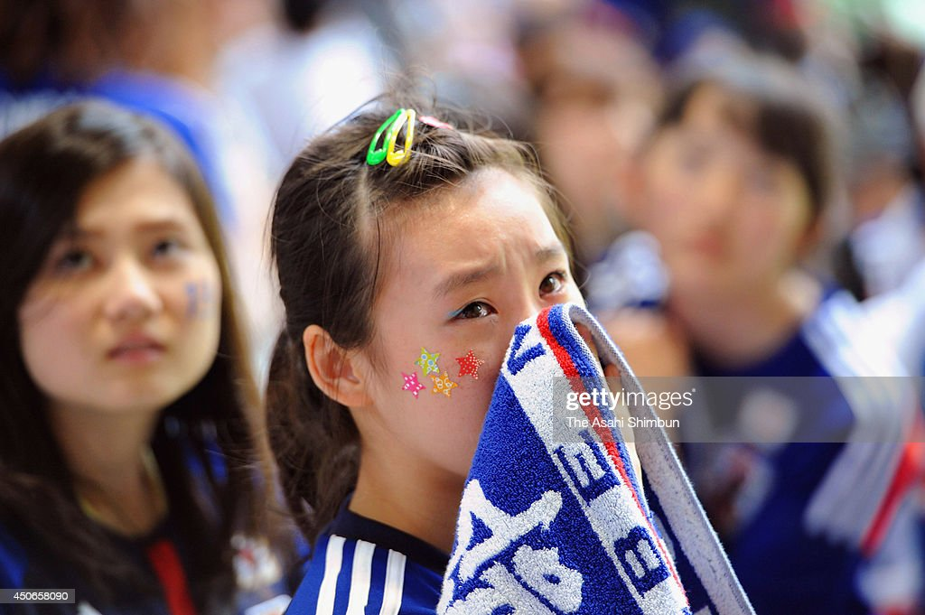 Japanese supporters show dejected after losing to Cote D'Ivoire during the public viewing at the Noevir Stadium Kobe on June 15, 2014 in Kobe, Hyogo, Japan.