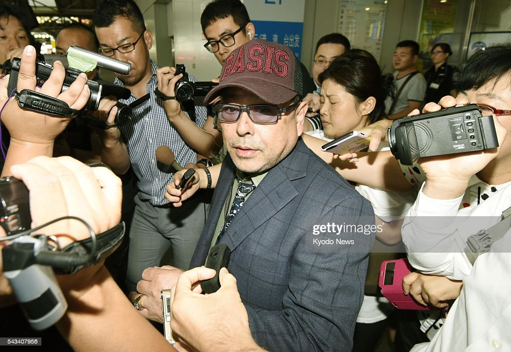 A Japanese sushi chef, known by the alias Kenji Fujimoto, is surrounded by reporters at Beijing's international airport on June 28, 2016, after returning from a trip to Pyongyang. Although Fujimoto said he planned to meet North Korean leader Kim Jong Un upon his departure to Pyongyang in late May, he did not disclose if he had met with Kim during the trip.
