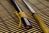 Japanese sword katana on a bamboo mat