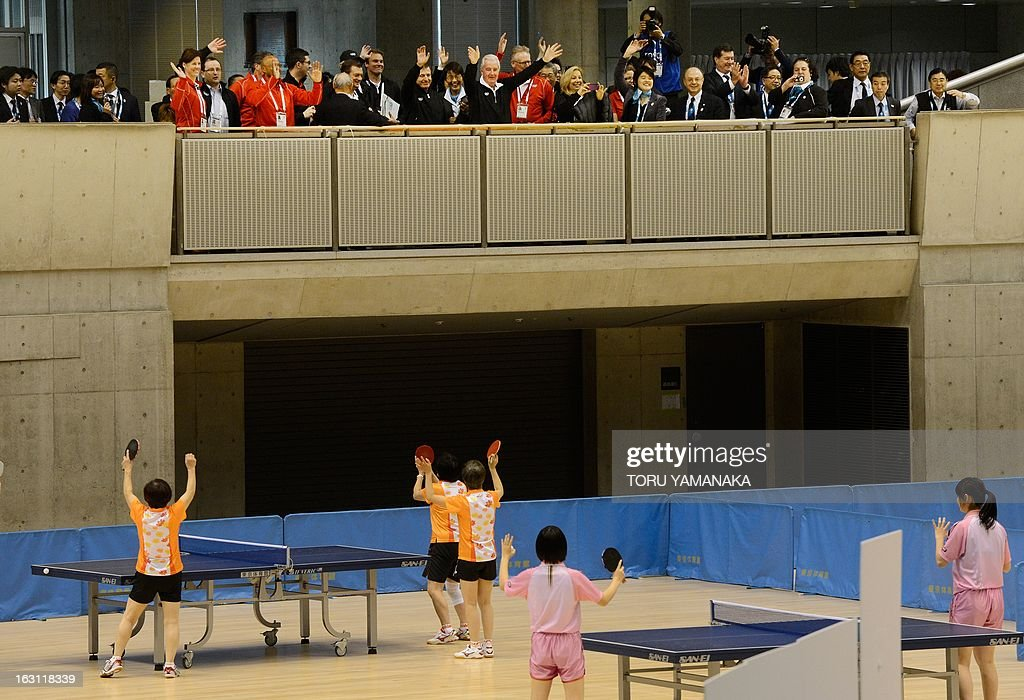 Japanese table tennis players welcome members of the International Olympic Committee (IOC) evaluation commission, led by Craig Reedie (top C) during the inspectors' visit Tokyo Metropolitan Gymnasium, a potential location for the 2020 Olympic Games table tennis, in Tokyo on March 5, 2013. Japan's corporate giants are ready to chip in for another Summer Olympics in Tokyo, hoping the Games will provide the same economic boost as the 1964 edition, Toyota's chairman said on march 5. AFP PHOTO / Toru YAMANAKA