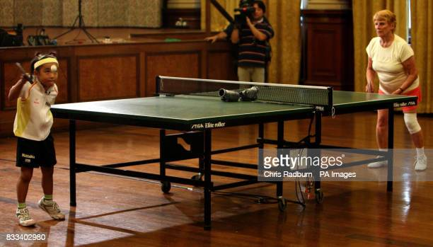 Japanese table tennis prodigy Mima Ito during a game against veteran table tennis champion Edna Fletcher held at Great Yarmouth Town Hall Norfolk