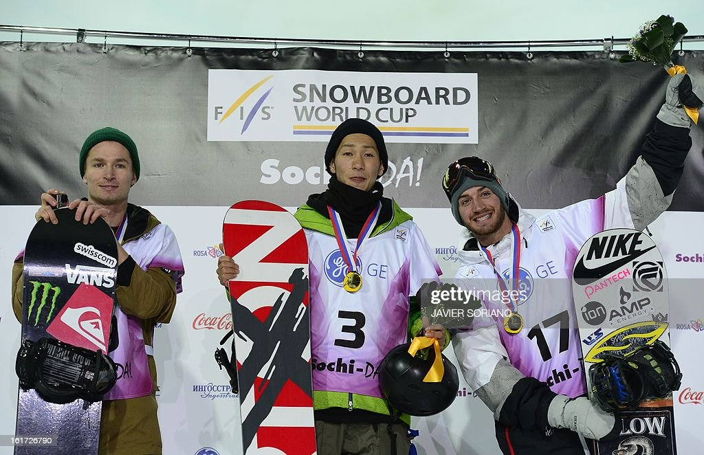 Japanese Taku Hiraoka (C), Swiss Luri Podladtchikov (L) and US Scott Lago pose for a photo on podium after Men's Half-Pipe final race during the Snowboarding and Free Style World Cup Test Event at the Snowboard and Free Style Centre in Rosa Khutor near the Russian Black Sea resort of Sochi on February 14, 2013. Japanese Taku Hiraoka won the race ahead of Swiss Luri Podladtchikov and US Scott Lago. AFP PHOTO / JAVIER SORIANO