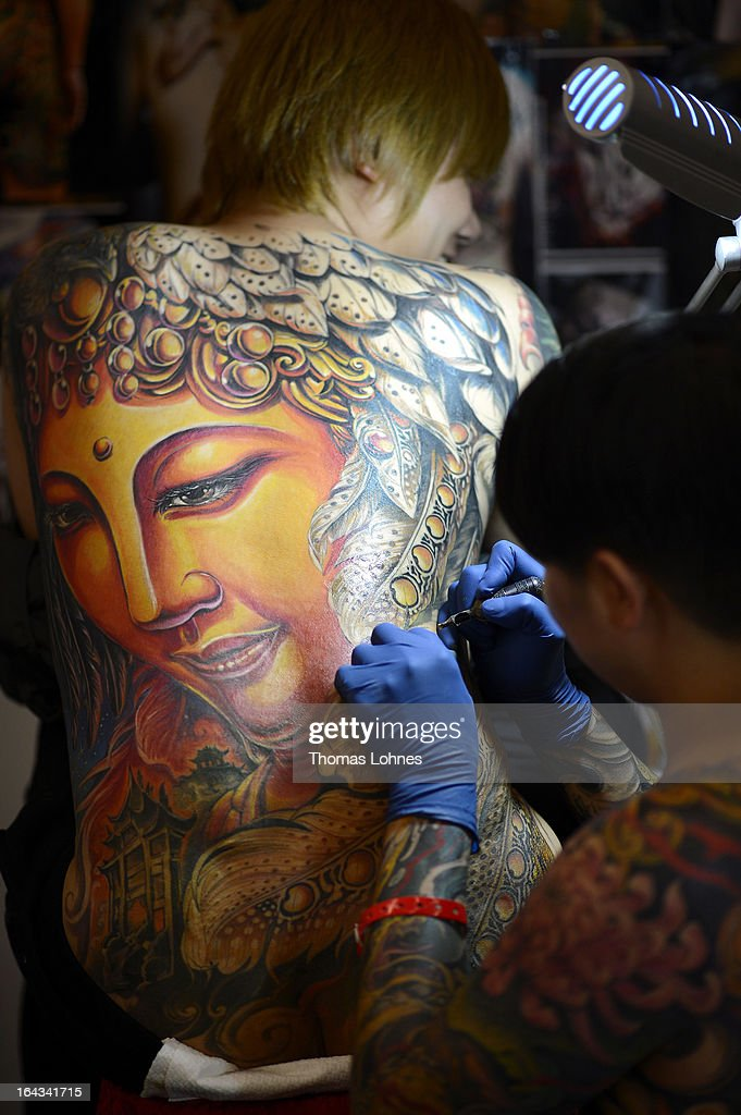 A Japanese tattoo artist tattooes a man during the International Tatoo Convention on March 22, 2013 in Frankfurt am Main, Germany. The Frankfurt tattoo convention is considered the world's biggest fair for the art of tattooing. More than 700 artists from all over the world will make more than 3,000 tattoos at the three-day show. The Hessian state laboratory has found carcinogens in some tattoo inks produced in China, causing warnings to be issued Europe-wide.