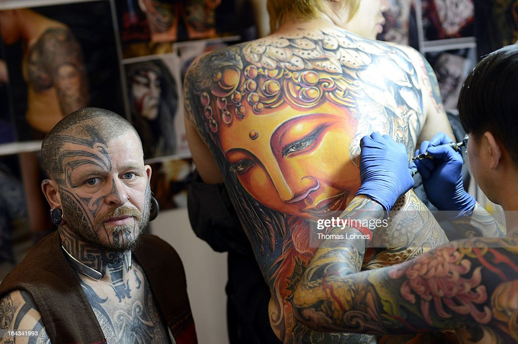A Japanese tattoo artist tattooes a man during the International Tatoo Convention on March 22, 2013 in Frankfurt am Main, Germany. The Frankfurt tattoo convention is the worldwide biggest fair for art of tattooing, according to the organizers. More than 700 artists from all over the world will make more than 3,000 tattoos at the three-day show.