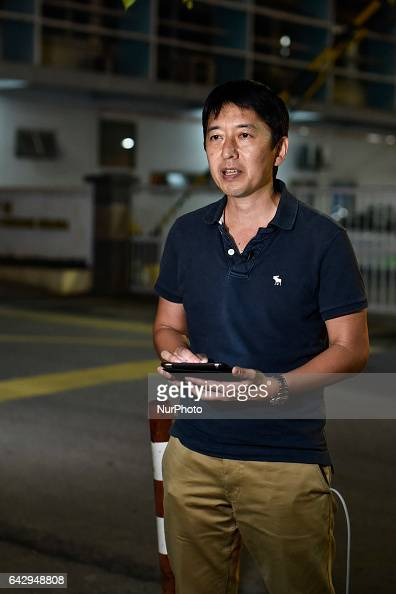 Japanese TBS news reporter handles a TBS news report about Kim Jongnam's a murder case at outside of Kuala Lumpur hospital on February 19 2017 at...