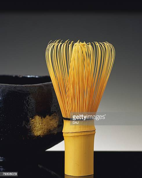 A Japanese tea whisk and a cup, Close Up