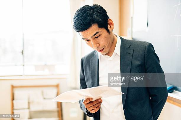 Japanese Teacher Preparing Before Class