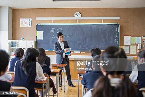 Japanese teacher using a digital tablet on his class