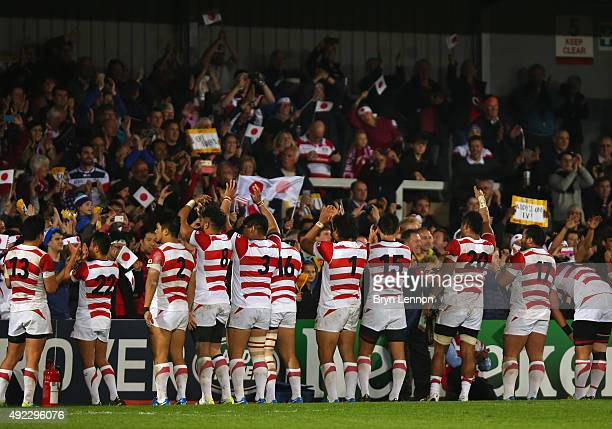 Japanese team celebrate after the 2015 Rugby World Cup Pool B match between USA and Japan at Kingsholm Stadium on October 11 2015 in Gloucester...