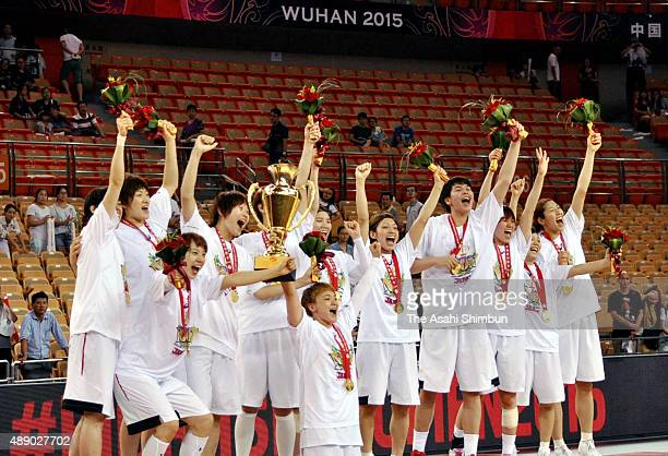 Japanese team celebrate after winning the final match between Japan and China during the 2015 FIBA Asia Championship for Women at Wuhan Sports Center...