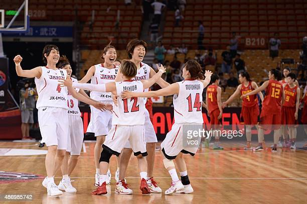 Japanese team celebrate after winning the finals match between Japan and China during the 2015 FIBA Asia Championship for Women at Wuhan Sports...