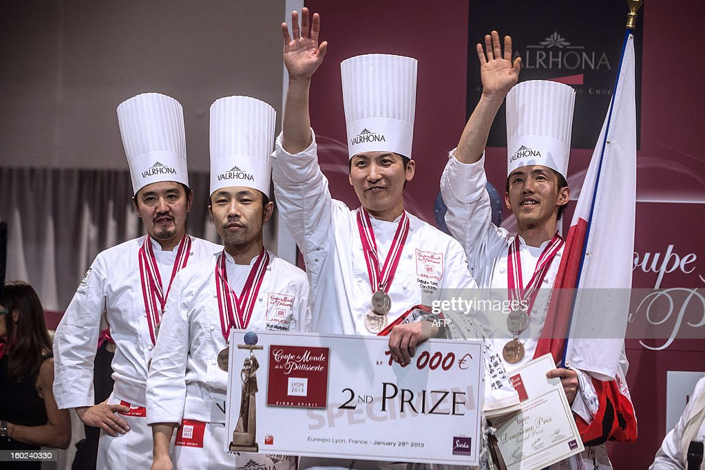 Japanese team composed of (RtoL) Tetsuro Akasaki, Daisuke Tomita, Koh Moriyama and Norihiko Terai celebrate after finishing second of the final of the World Cup of pastries, on January 28, 2013 during the catering and food international show (SIRHA), in the French central town of Chassieu, near Lyon. AFP PHOTO / JEFF PACHOUD