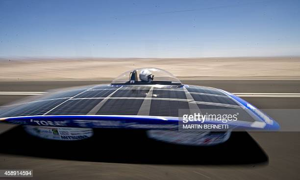 Japanese team Tokai competes in the first stage of the Atacama Solar Challenge a solar car race in the Atacama Desert in Iquique some 2000 km north...