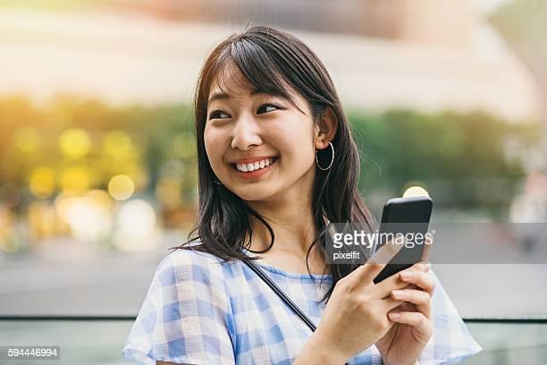 Japanese teenage girl with smart phone