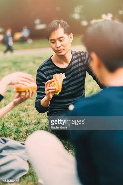 Japanese teenager eating outside