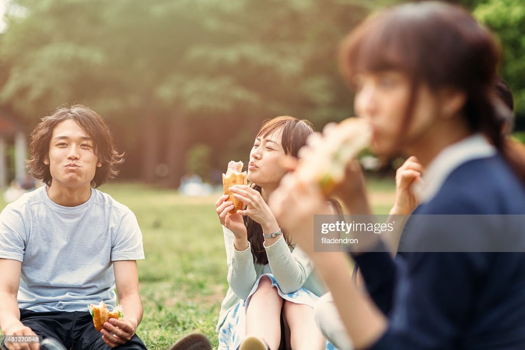 Japanese teenager eating outside : Stock Photo