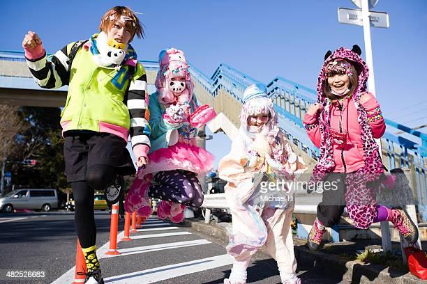 Japanese teens jumping in Harajuku, Tokyo