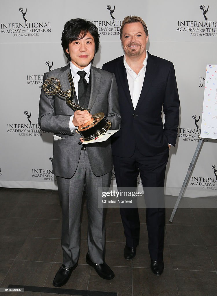 Japanese television director Hiroki Hayashi with the Kids; Series Emmy Award for 'Junior High School Diaries: Harmony of Two' and British stand-up comedian/actor/writer <a gi-track='captionPersonalityLinkClicked' href=/galleries/search?phrase=Eddie+Izzard&family=editorial&specificpeople=204152 ng-click='$event.stopPropagation()'>Eddie Izzard</a> attend The Inaugural International Emmy Kids Awards at The Lighthouse at Chelsea Piers on February 8, 2013 in New York City.