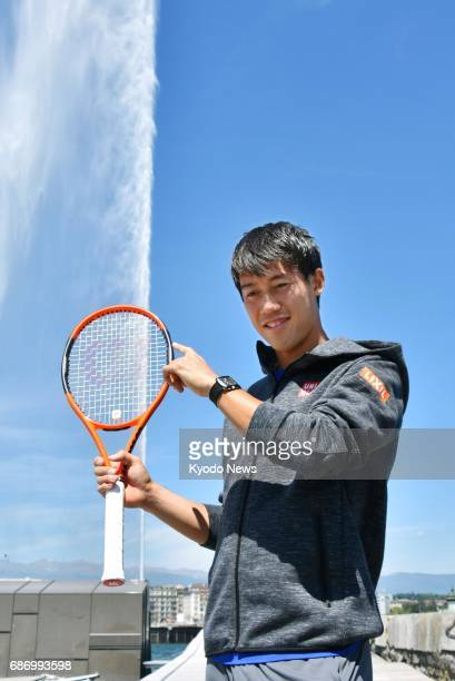 Japanese tennis player Kei Nishikori poses in front of the Jet d'Eau a large water fountain in Lake Geneva on May 22 2017 Nishikori is scheduled to...