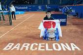 Japanese tennis player Kei Nishikori poses with the trophy and the japanese flag after to wing the 63th edition Barcelona Open Banc Sabadell in the...