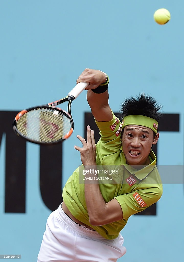 Japanese tennis player Kei Nishikori serves to French tennis player Richard Gasquet during the Madrid Open tournament at the Caja Magica (Magic Box) sports complex in Madrid on May 5, 2016. / AFP / JAVIER