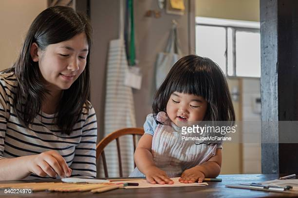 Japanese Toddler and Teenaged Girl Drawing and Playing with Paper