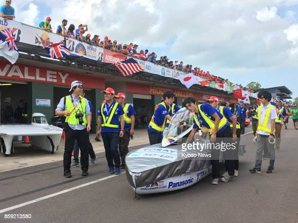 Japanese Tokai University team members roll out their solar car for time trials in Darwin on Oct 8 before competing in a 3000kilometer endurance race...