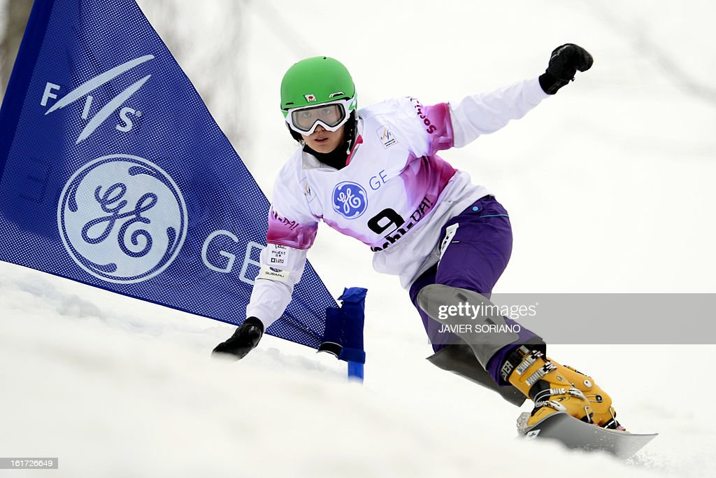 Japanese Tomoka Takeuchi competes in a Snowboard Ladies' Parallel Giant Slalom final race during the Snowboarding and Free Style World Cup Test Event at the Snowboard and Free Style Centre in Rosa Khutor near the Russian Black Sea resort of Sochi on February 14, 2013. Austrian Marion Kreinerwon the race ahead of German Ameli Kober and Canadian Ariane Lavigne.