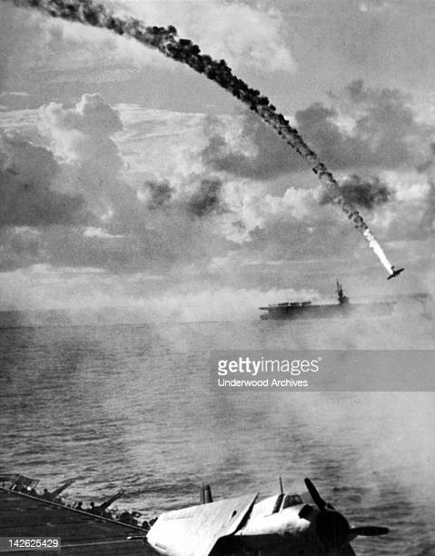 A Japanese torpedo plane crashes in flames from a direct hit from carrier antiaircraft fire Saipan Northern Mariana Islands October 15 1945
