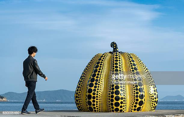 Japanese Tourist and Yellow Pumpkin of Kusama Yayoi Naoshima Japan