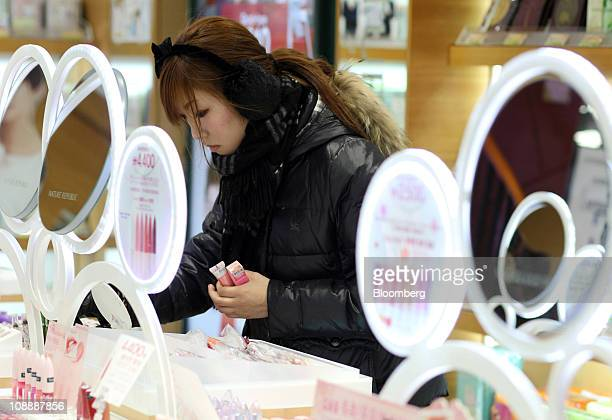 A Japanese tourist looks at beauty products for sale at a Nature Republic cosmetics store in the Myeongdong shopping district of Seoul South Korea on...