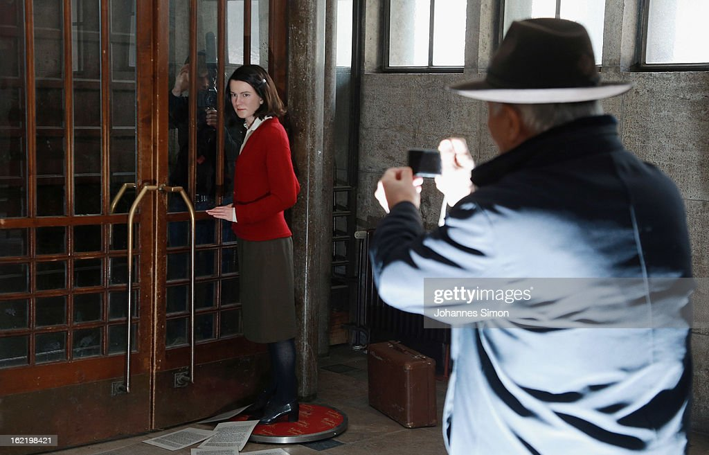 A Japanese tourist takes pictures of a Madame Tussauds wax effigy of Sophie Scholl, one of the most famous members of the German World War II anti-Nazi resistance movement, The White Rose is displayed near to one of the backside entrance doors at Ludwig Maximilian University on February 20, 2013 in Munich, Germany. Sophie Scholl, whose active opposition to the Nazis led to her execution 70 years ago, was a student at Munich University, where she printed and distributed anti-Nazi leaflets. To commemorate the day of her death, the wax effigy was moved for a photo call to Munich from Madame Tussauds wax cabinet at Berlin.