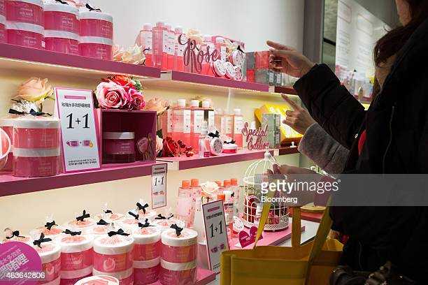 Japanese tourists browse cosmetics at an Amorepacific Corp Mamonde store in the Myeongdong shopping district in Seoul South Korea on Monday Feb 16...