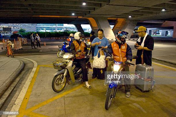 Japanese tourists desperate to try their luck at the Suvarnabhumi airport during the second day of its occupation by the antigovernment People's...