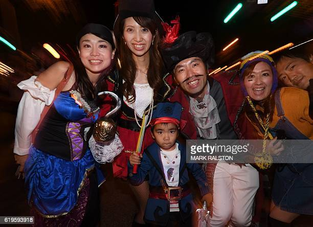 Japanese tourists from Tokyo dressed in colorful Halloween costumes parade along Santa Monica Blvd during the annual street Halloween festival in...