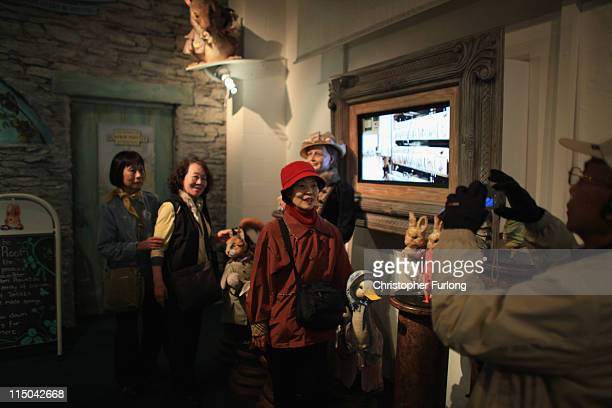 Japanese tourists take holiday photographs at The World of Beatrix Potter attraction on June 1 2011 in Windermere United Kingdom The English Lake...