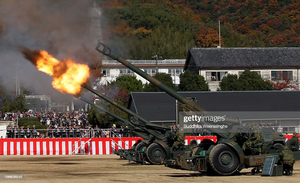 Japanese Towed FH70 artillery guns fire during the annual Japan Ground Self-Defense Force (JGSDF) military demonstration on November 25, 2012 in Himeji, Japan. The military exhibition and demonstration marks the 61-year anniversary of the Japan Ground Self-Defense Force based in Himeji.