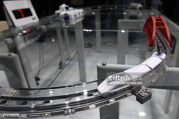 Japanese toy maker Takara Tomy's new maglev train toy 'LinearLiner' is demonstrated during a press preview in Tokyo on May 26 2015 The toy uses...