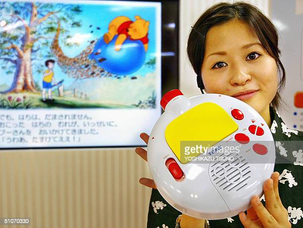 Japanese toy maker Tomy unveils a portable digital projector 'Fantasium' which enables it to project slide show of picture books onto walls of...