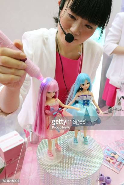 Japanese toymaker Tomy Co displays Liccachan dolls whose hair color changes from pink to blue when lighted at the International Tokyo Toy Show at...