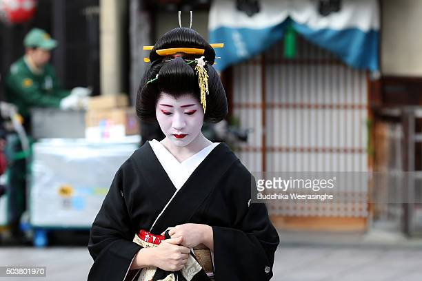 Japanese traditional female dancers maiko walks in the street during the new year's ceremony at the Gion Kobu Kaburenjo Theater on January 7 2016 in...