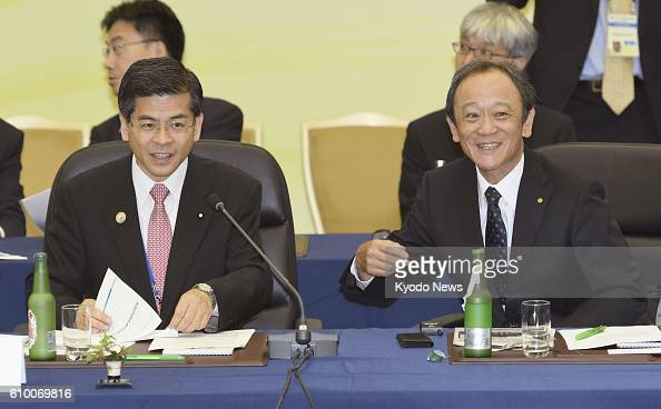 Japanese transport minister Keiichi Ishii and Toyota Motor Corp Senior Managing Officer Kiyotaka Ise attend a joint meeting of transport ministers...