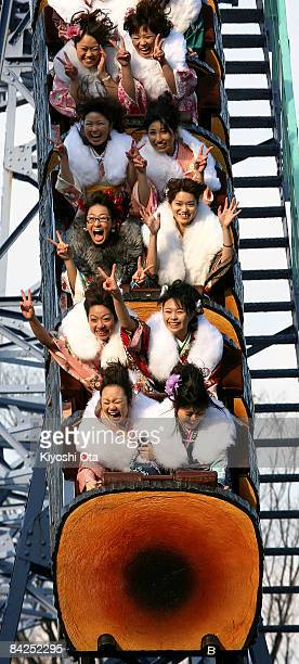 Japanese twentyyearolds dressed in traditional kimonos enjoy riding a roller coaster after attending the annual ComingofAge Day ceremony at Toshimaen...